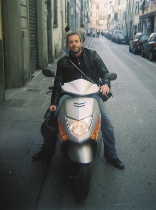 John McCalla on a scooter; Florence, Italy